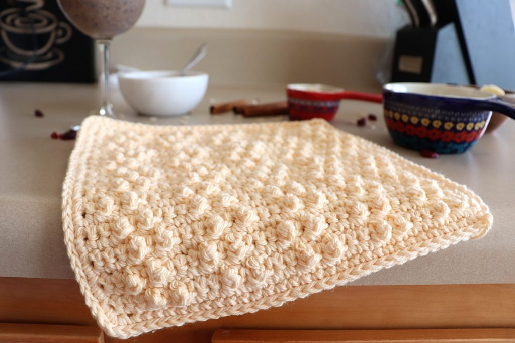 A photo of the Treble Pop Washcloth Crochet Pattern - 1 of the 5 pretty, quick, and beginner friendly crochet washcloth patterns