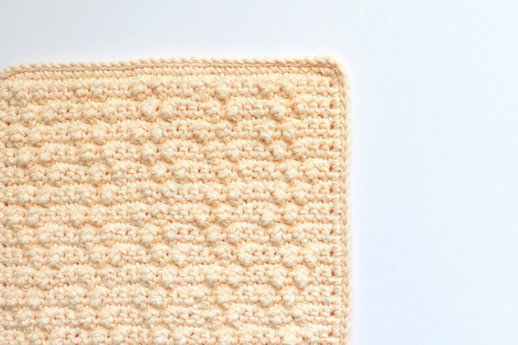 This shows a photo of the treble pop washcloth crochet pattern finished and ready to get to cleaning!