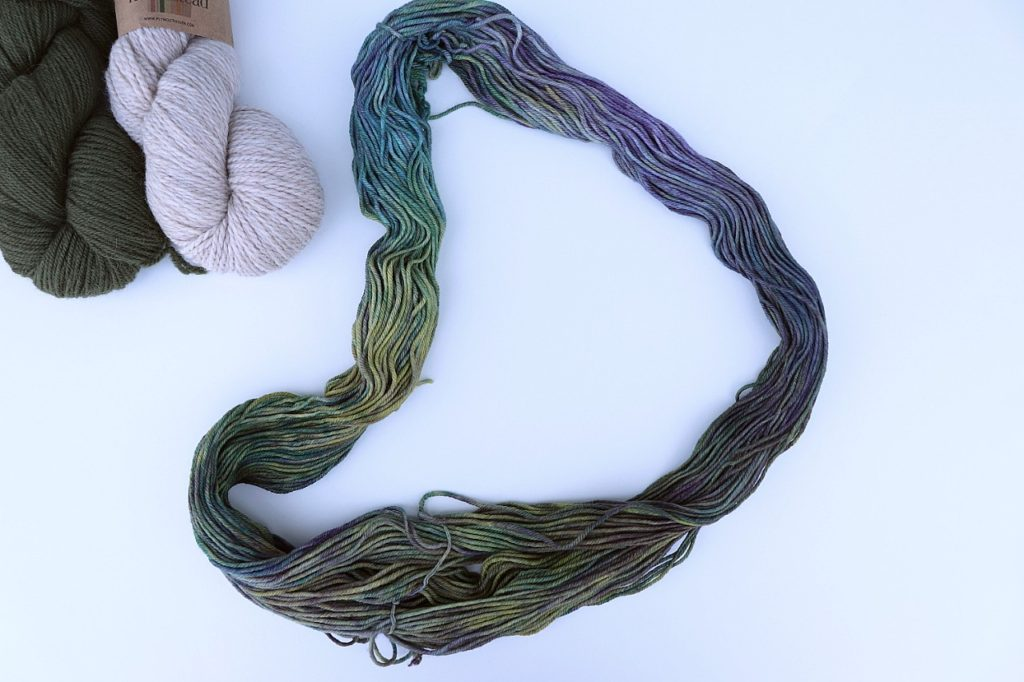 A photo showing what a yarn hank looks like wound up and as it is dyed. via Sigoni Macaroni's How to Choose the Right Yarn for Crochet Beginners