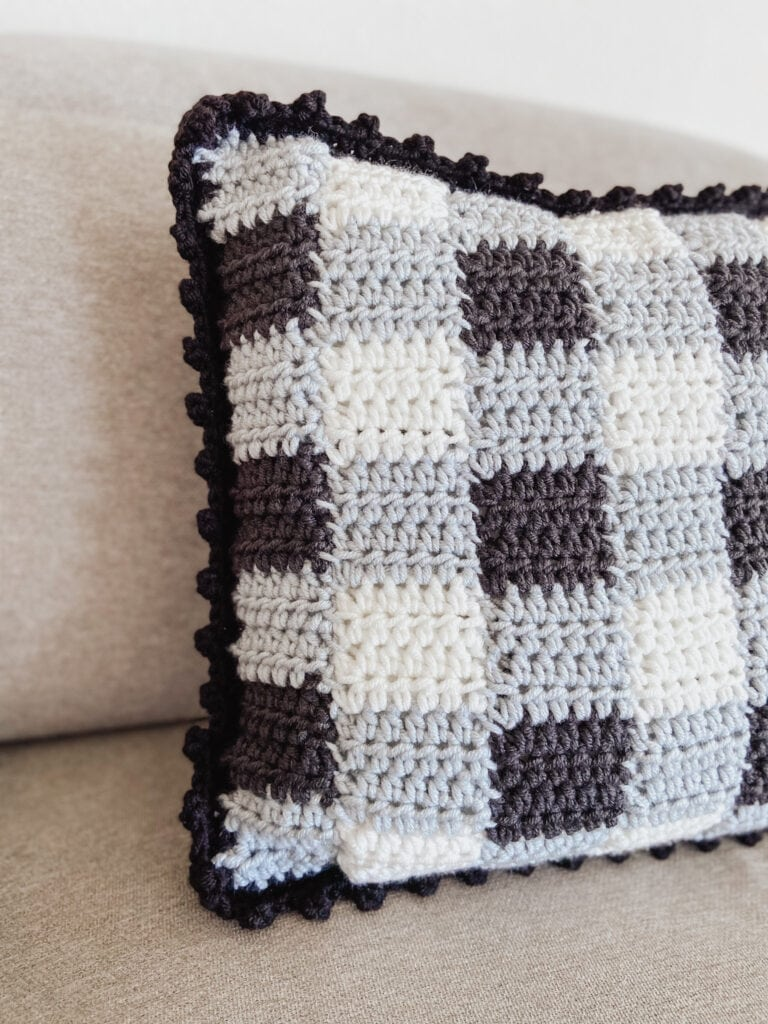 gingham crochet pillow cover using traditional colors (black, grey, white)