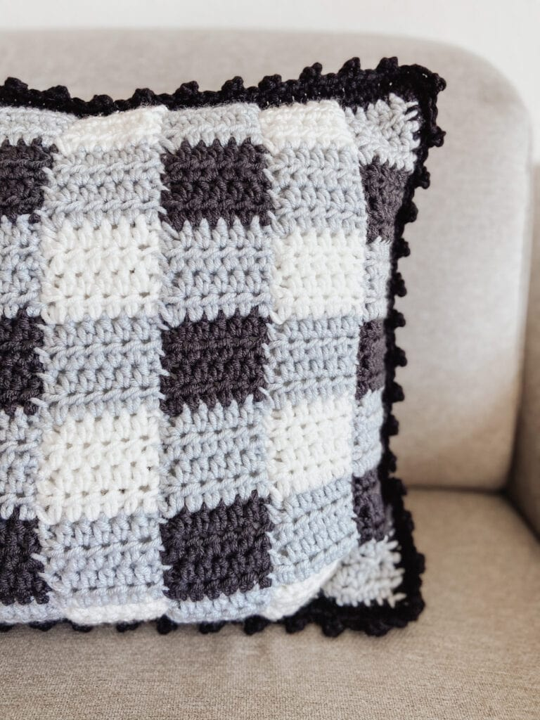 Gingham Style Crochet Pillow Cover using traditional gingham colors (white grey black) and a bobble edge