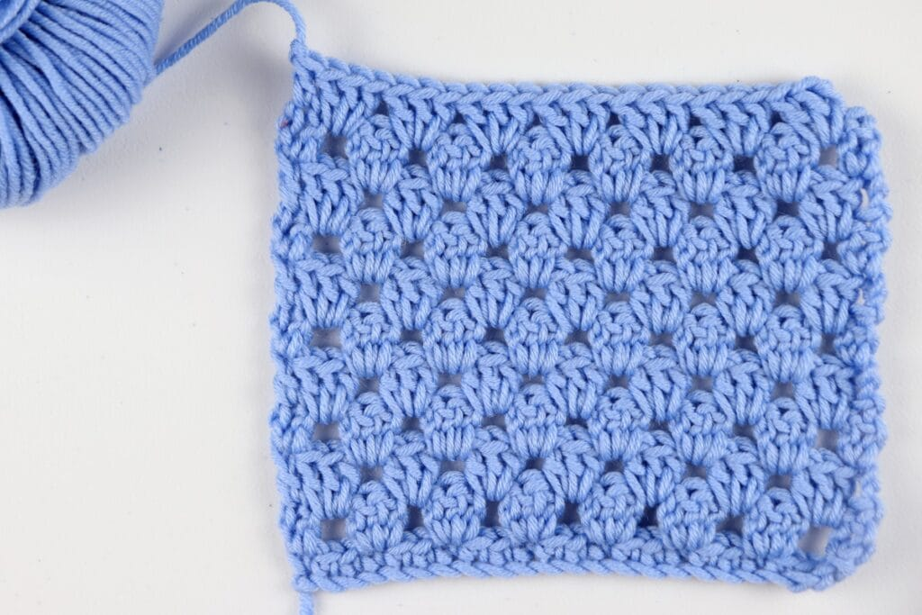 The finished Granny Stripe Stitch swatch sample in the color purple using Milla Mia yarn.